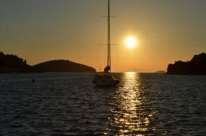 Vela Luka sunset with islet Osjak